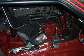 Aluminum seat, brake bias adjuster and fire extinguisher.